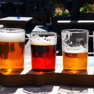 A paddle of beer at a brewery taproom